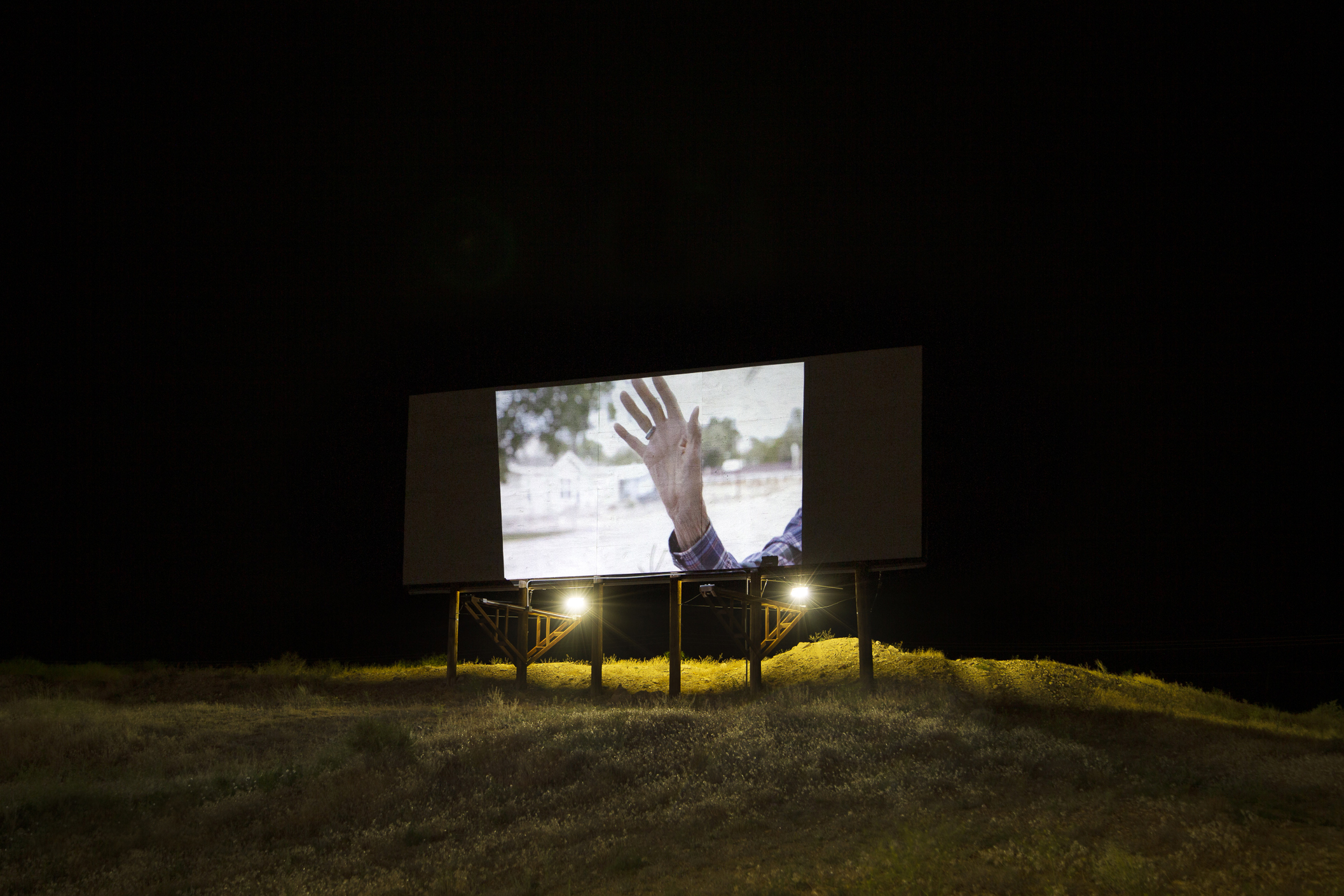 Calista Lyon, Localized Gesture, 2019, video projected on a billboard