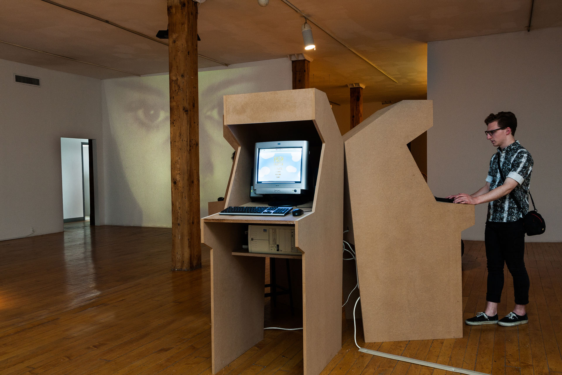Arcade units playing various video games, installation view
